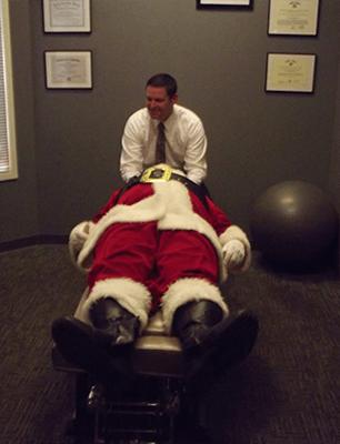 Chiropractor Rolesville NC Dr Lucas Kruse adjusting santa